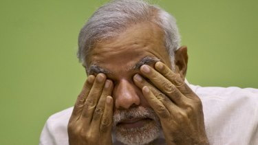 Indian Prime Minister Narendra Modi rubs his eyes as he attends a conference in Delhi earlier this year.
