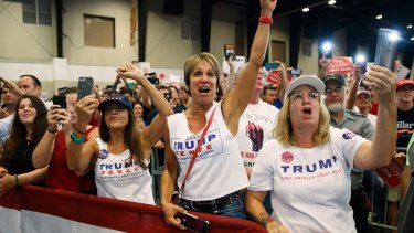 Mad as hell. Supporters of Republican presidential candidate Donald Trump cheer during a campaign rally in Florida.
