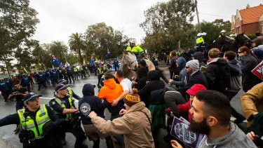 Police hold back members of the 'Say no to Racism' group who were protesting an anti-Islam rally organised by the True Blue Crew and backed by the United Patriots Front.