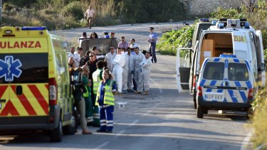 An ambulance is parked along the road where a car bomb exploded killing investigative journalist Daphne Caruana Galizia, in the town of Mosta, Malta.