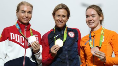 Russian silver medallist Olga Zabelinskaya (left) on the podium for the individual time trial. She had originally been banned from the Games for her doping history.