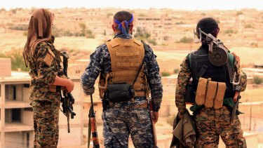 Fighters from the US-backed Syrian Democratic Forces looking towards the town of Tabqa, Syria.