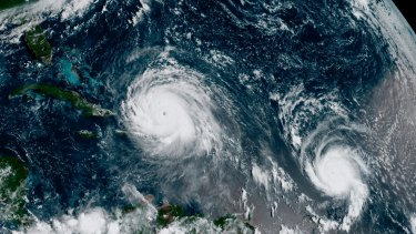 The eye of Hurricane Irma, left, just north of the island of Hispaniola, with Hurricane Jose, right, in the Atlantic Ocean. In a four-week span, hurricanes Harvey, Irma and Maria ravaged Texas, Florida, Puerto Rico and other Caribbean islands last year.