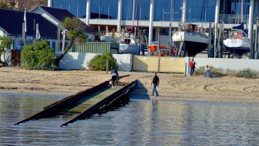 A fight has broken out at Royal Brighton Yacht Club's over its unusable boat ramp, which has left six yachts stranded inside repair yards there.