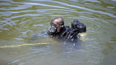 A police diver in the Maribynong River.