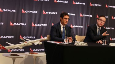 Qantas chief executive Alan Joyce, right, with chief financial officer Tino La Spina at the airline's half-year results meeting on Tuesday.