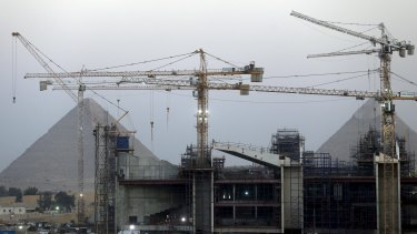 Construction is seen at the new museum in front of the Giza pyramids area, on the outskirts of Cairo last month.