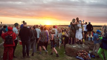 Fans enjoy the sunset as much as the music.