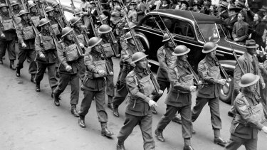 US and Australian troops march in Martin Place, Sydney, for the launch of the National Saving Campaign drive for war funds, 17 April 1942.