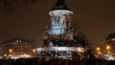 Crowds gather at the Place de la Republique in Paris to protest against the killing of <i>Charlie Hebdo</i> magazine staff by terrorist gunmen.