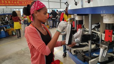 A factory worker make shoes at the Chinese company Huajian's plant in Addis Ababa, Ethiopia. Huajian produces some Ivanka Trump products. Huajian workers in China say they face long hours, low pay and verbal abuse. Huajian has been moving some of its production to Ethiopia, where labour costs are even lower.