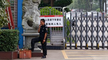 A security guard at the Ganzhou Huajian International Shoe City Co, which has been used by Ivanka Trump's brand.
