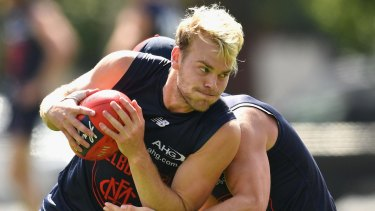 Jack Watts is tackled by Angus Brayshaw during a Melbourne training session last week.