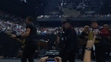Springsteen was joined by four bandmates including saxophonist Jake Clemons and singer Patti Scialfa.