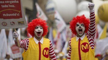 Two demonstrators dressed as Ronald McDonald protest for better wages for McDonald's employees in Sao Paulo, Brazil.