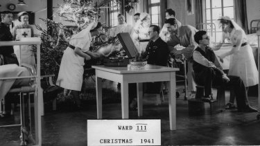 So this is Christmas: Nurses and patients in 1941 in Ward III at Queen Victoria Hospital, East Grimstead.