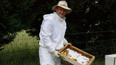 Niall Blair with his backyard beehive in the Southern Highlands.