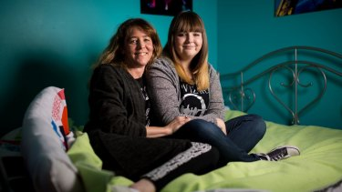 """Kellie Oakley and her daughter Jordon. """"I rely on all four of them,"""" says Kellie of her three teenage children and husband."""