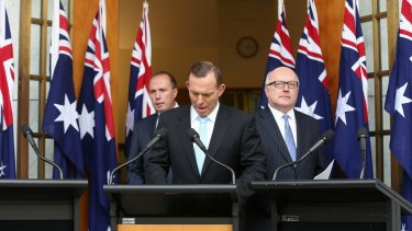 Prime Minister Tony Abbott with Immigration Minister Peter Dutton and Attorney-General George Brandis during a joint press conference at Parliament House on Tuesday.