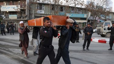 Four men carry the coffin from a deadly suicide attack in Kabul, Afghanistan.