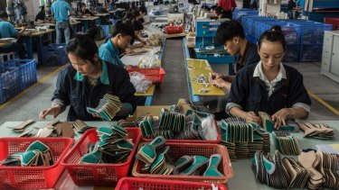 Workers on the assembly line at the Huajian shoe factory in Dongguan, China, where shoes for Ivanka Trump's company have been produced.