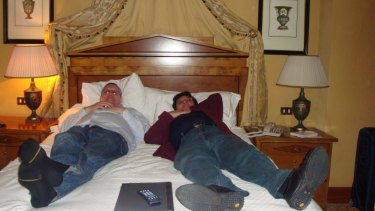 London holiday: Former Education Department officials Jeff Rosewarne (left) and Nino Napoli (right) on a hotel bed in London, evidence tendered at IBAC hearing on Tuesday.