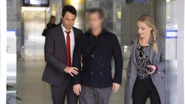 Detectives arrest Gene Scorringe at a Bondi Junction clinic on Thursday.