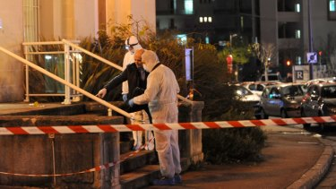 Police collect evidence outside the police station at Joue-les-Tours.