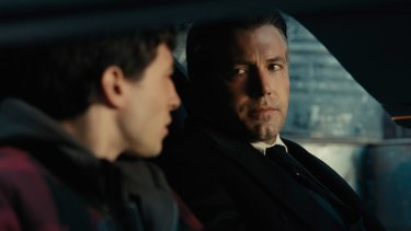 Ezra Miller, left, and Ben Affleck drop their superhero personas in a scene from <i>Justice League</i>.