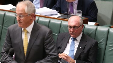Deputy Prime Minister Warren Truss rests his eyes while Prime Minister Malcolm Turnbull is at the dispatch box during question time on Thursday.