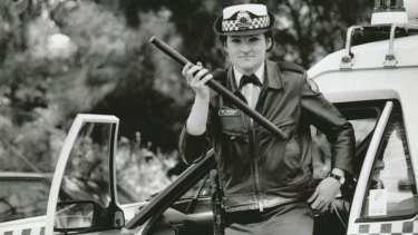 Constable Carmel Phillips carrying a baton on the beat in 1994.