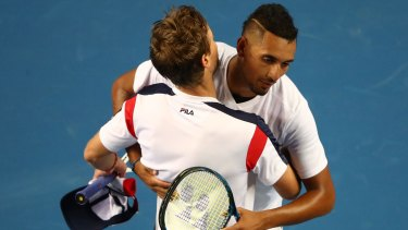 A despondent Nick Kyrgios congratulates Andreas Seppi after his five-set loss.