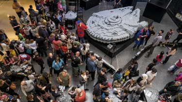 Families join forces at a LEGO event to build the Millennium Falcon to celebrate Star Wars Day at Westfield Southland.