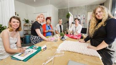 Daisy Watt, right, with the Toast Workroom residents.