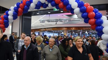 Shoppers enter the new Kmart  at Top Ryde Shopping Centre.