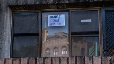 A sign hangs on the exterior of the Sirius building at 36-50 Cumberland Street.