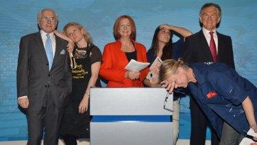 Madam Tussauds Sydney staff Zoe Walton (leaning on John Howard), Crystal Kranz (rear) and Jan Cowell (front).