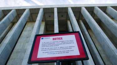 A closure sign stands outside of the Library of Congress in Washington on Saturday.