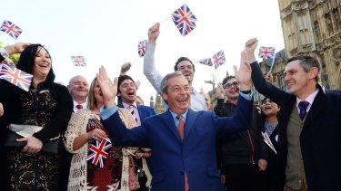 Nigel Farage, the leader of the UK Independence Party celebrates the Brexit result with his supporters in London.
