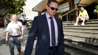 Cameron White leaves the Downing Centre Court, in Sydney last week.