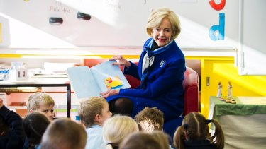 Dame Quentin reads to kindergarten students in 2013.