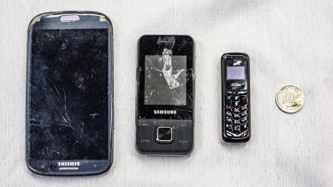 Small mobile phones have made their way into the Alexander Maconochie Centre (AMC) by being smuggled in body cavities.