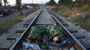 Syrian refugees sleeping on a railroad track near the train station of Idomeni, in northern Greece, this week.