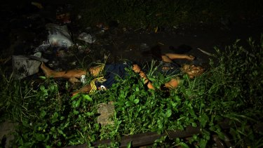 The body of one of the three men slain. According to people living in the area there was a gun battle for approximately one hour.