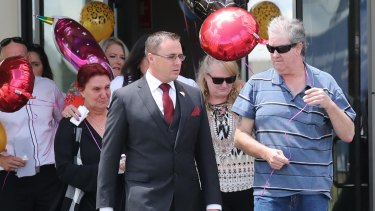 The grief-stricken family of Lauren Brownlee leave her funeral on Friday.