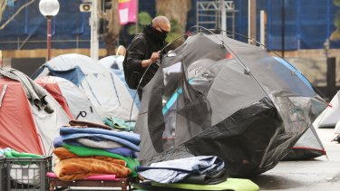 The residents of Martin Place's tent city prepare to move on.