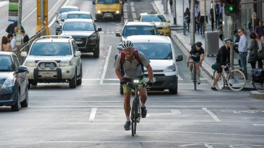 A cyclists uses the La Trobe Street bike lane.