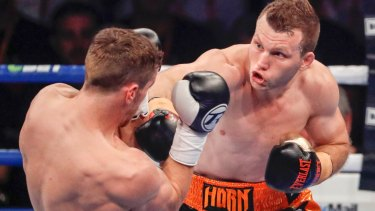 Big hit: Jeff Horn retains his world title against Gary Corcoran in Brisbane.