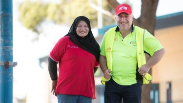 Workers Mahani Mohd Tif and Vince Tropea have won better pay and conditions.