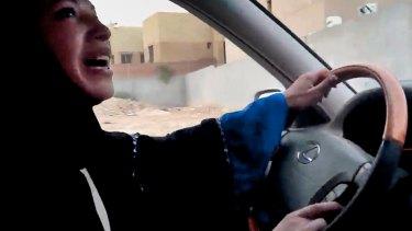 June 2011: a Saudi Arabian woman drives a car in the capital Riyadh in defiance of the kingdom's prohibition.